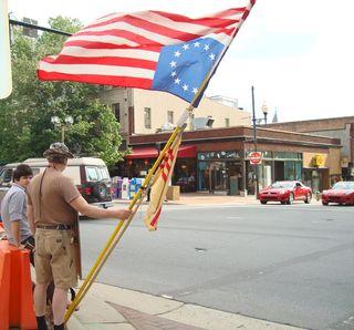 Asheville Upsidedown American Flag Protester